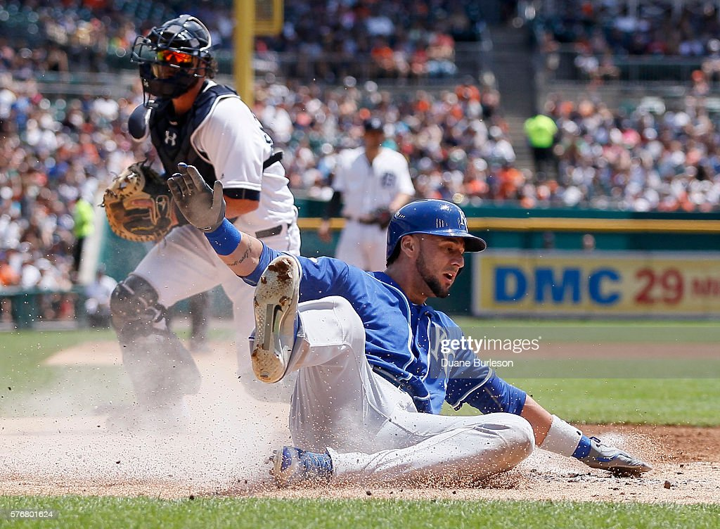 Paulo Orlando of the Kansas City Royals scores against catcher Jarrod Saltalamacchia of the Detroit Tigers on a double by Cheslor Cuthbert of the...