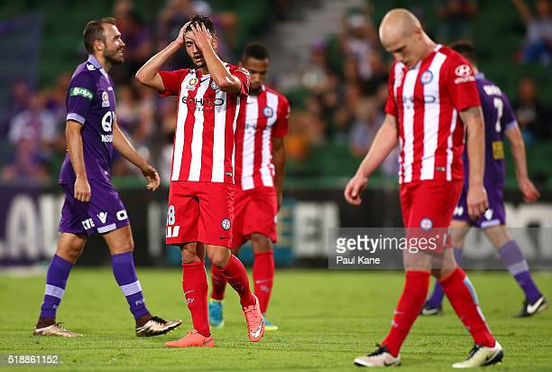 Paulo Retre and Aaron Mooy of Melbourne react after the final whistle during the round 26 ALeague match between the Perth Glory and Melbourne City FC...