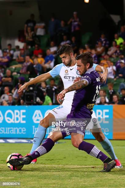 Paulo Retre of Melbourne and Josh Risdon of the Glory contest for the ball during the round 27 ALeague match between the Perth Glory and Melbourne...