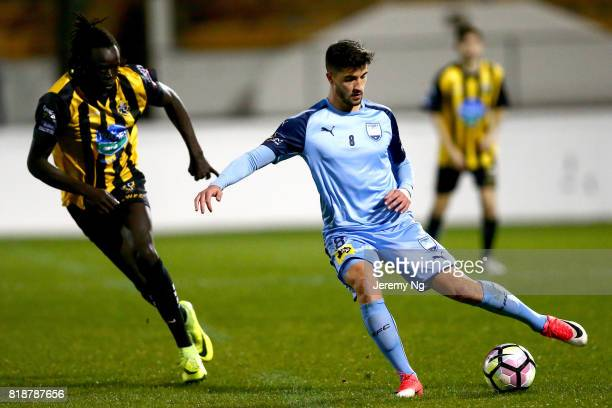 Paulo Retre of Sydney FC passes the ball under pressure by Garang Awac of the Wanderers during the 2017 Johnny Warren Challenge match between Sydney...