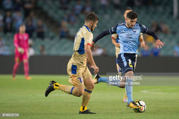 Paulo Retre of the Sydney FC takes on Jets Ivan Vujica during the round seven ALeague match between Sydney FC and Newcastle Jets at Allianz Stadium...