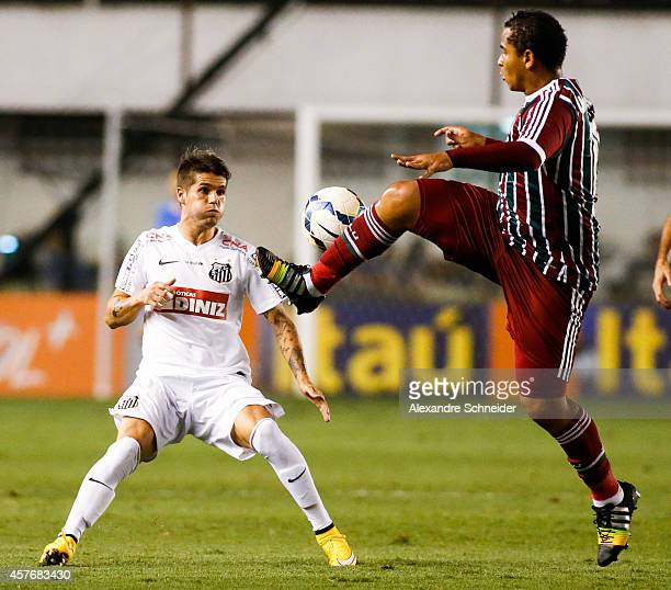 Paulo Ricardo of Santos and Walter of Fluminense in action during the match between Santos and Fluminense for the Brazilian Series A 2014 at Vila...