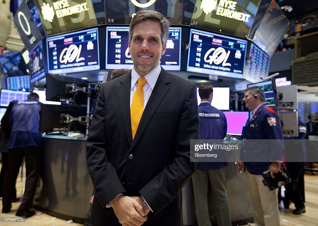 Paulo Sergio Kakinoff, chief executive officer of Gol Linhas Aereas Inteligentes SA, stands for a photograph after ringing the closing bell on the floor of the New York Stock Exchange (NYSE) in New York, U.S., on Monday, June 24, 2013. U.S. stocks fell after Chinese equities entered a bear market on concern a cash crunch will hurt growth. Treasuries pared losses on speculation investors overreacted to a possible reduction of central bank stimulus. Photographer: Jin Lee/Bloomberg via Getty Images