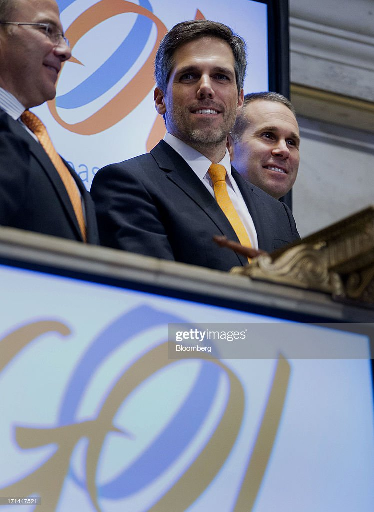 Paulo Sergio Kakinoff, chief executive officer of Gol Linhas Aereas Inteligentes SA, center, waits to ring the closing bell on the floor of the New York Stock Exchange (NYSE) in New York, U.S., on Monday, June 24, 2013. U.S. stocks fell after Chinese equities entered a bear market on concern a cash crunch will hurt growth. Treasuries pared losses on speculation investors overreacted to a possible reduction of central bank stimulus. Photographer: Jin Lee/Bloomberg via Getty Images