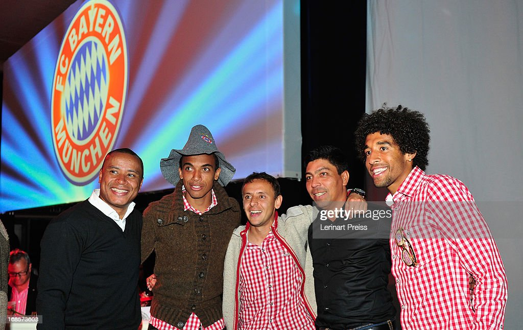 Paulo Sergio, Luiz Gustavo, Rafinha, Giovane Elber and Dante celebrate winning the German Championship during the Official Champion dinner after winning the German championship at Postpalast on May 12, 2013 in Munich, Germany.