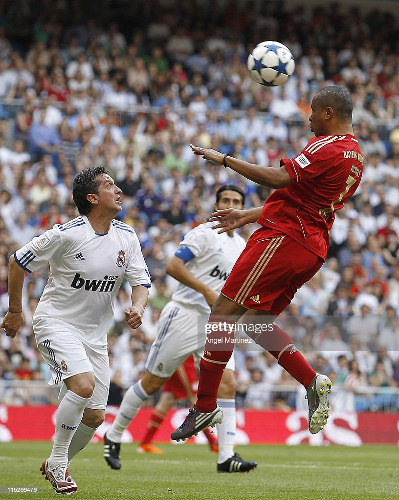 Paulo Sergio of Bayern Muenchen heads the ball beside Miguel Porlan of Real Madrid during the Corazon Classic Match between Allstars Real Madrid and...