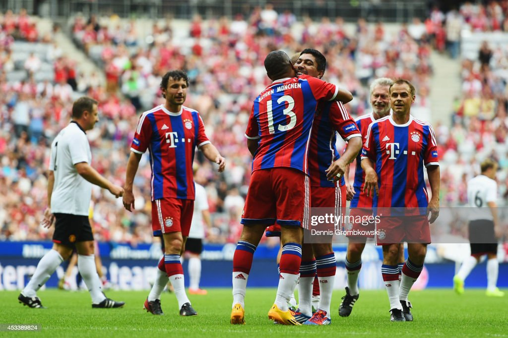 Paulo Sergio of FCB AllStars celebrates with team mate Giovane Elber after scoring his team's first goal during the friendly match between FC Bayern...