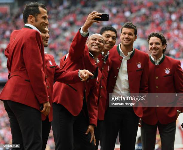 Paulo Sergio takes a selfie with Giovane Elber Michael Ballack and Owen Hargreaves prior to the Bundesliga match between Bayern Muenchen and SC...