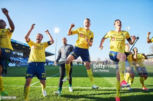 Paulus Arajuuri Hjortur Hermannsson and Gustaf Nilsson of Brondby IF celebrate after the Danish Alka Superliga match between Lyngby BK and Brondby IF...