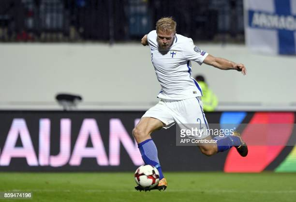 Paulus Arajuuri of Finland shoots to score the 11 equalizer during the FIFA World Cup 2018 qualifying football match between Finland and Turkey in...