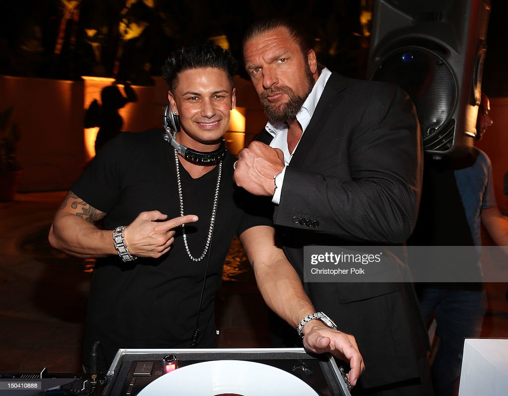DJ Pauly D and WWE Superstar <a gi-track='captionPersonalityLinkClicked' href=/galleries/search?phrase=Triple+H&family=editorial&specificpeople=239176 ng-click='$event.stopPropagation()'>Triple H</a> attend the WWE SummerSlam VIP Kick-Off Party at Beverly Hills Hotel on August 16, 2012 in Beverly Hills, California.