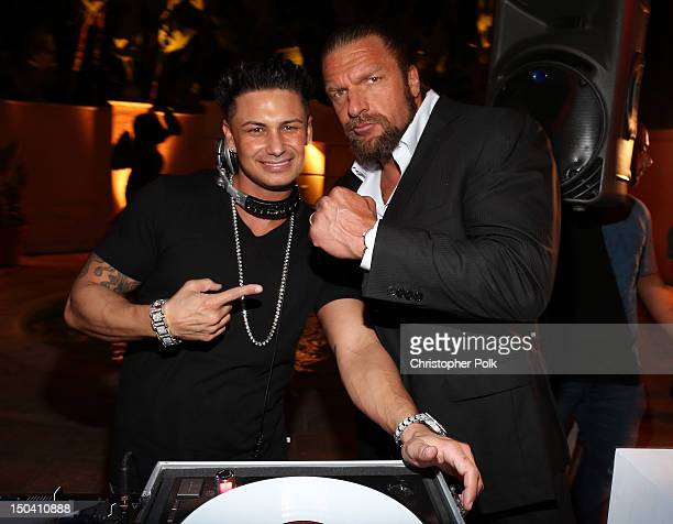 Pauly D and WWE Superstar Triple H attend the WWE SummerSlam VIP KickOff Party at Beverly Hills Hotel on August 16 2012 in Beverly Hills California