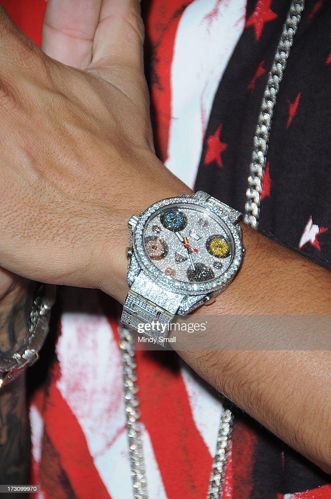 DJ Pauly D (watch detail) arrives at Haze Nightclub at Aria on July 6, 2013 in Las Vegas, Nevada.