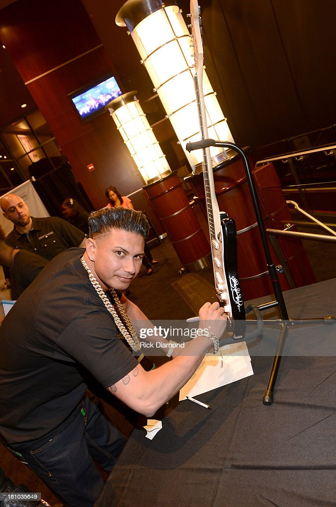 DJ Pauly D poses backstage at the GRAMMYs Dial Global Radio Remotes during The 55th Annual GRAMMY Awards at the STAPLES Center on February 8, 2013 in Los Angeles, California.