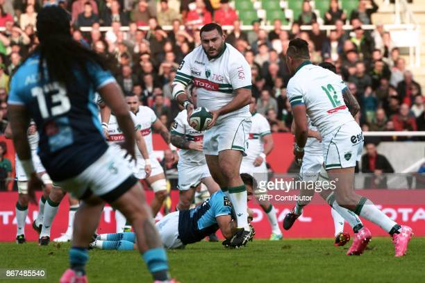 Pau's Alegerian prop Malik Hamadache passes the ball during the French Top 14 rugby union match between Pau and Montpellier at the Hameau Stadium in...