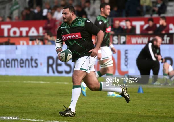 Pau's Algerian prop Malik Hamadache warms up before the French Top 14 rugby union match between Pau and Montpellier at the Hameau Stadium in Pau...