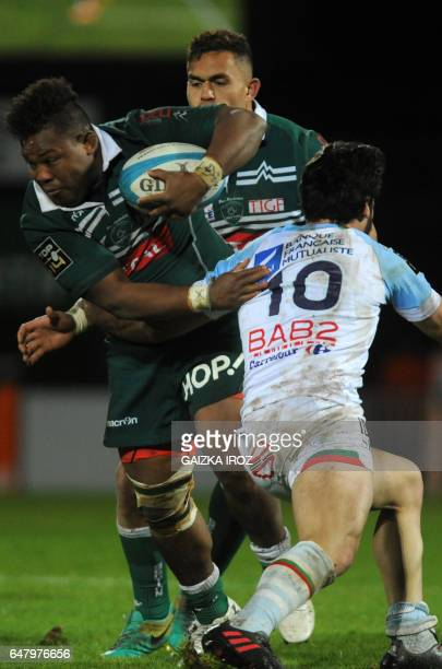Pau's British flanker Steffon Armitage vies with Bayonne's French flyhalf Raphael Lagarde during the French Top 14 rugby union match between...