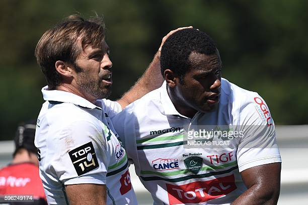 Pau's Fijian winger Watisoni Votu is congratulated by Pau's New Zealander centre Conrad Smith after scoring a try during the French Top 14 rugby...
