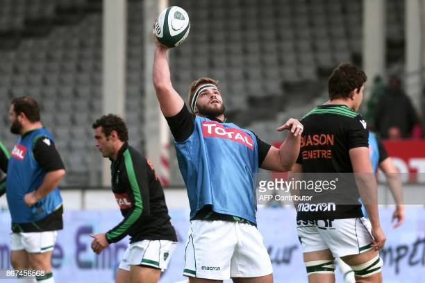 Pau's French hooker Quentin LespiaucqBrettes warms up before the French Top 14 rugby union match between Pau and Montpellier at the Hameau Stadium in...