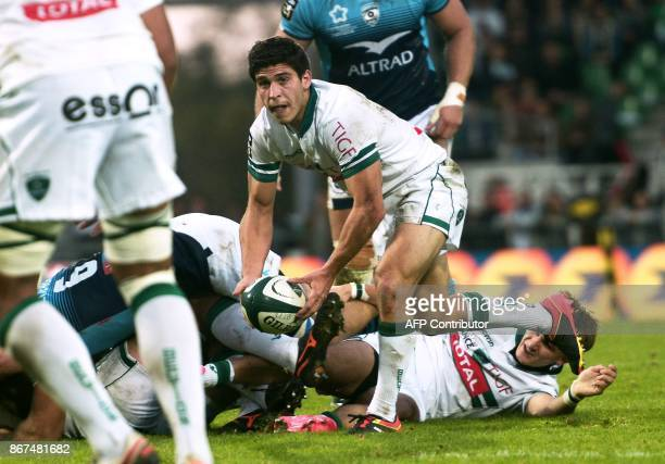 Pau's French scrumhalf Thibault Daubagna passes the ball during the French Top 14 rugby union match between Pau and Montpellier at the Hameau Stadium...