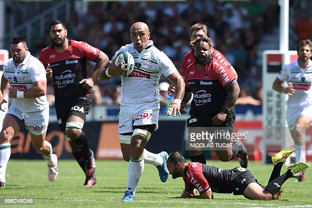 Pau's Moroccan lock Abdellatif Boutaty runs with the ball during the French Top 14 rugby union match between Pau and Toulon on August 27 2016 at the...