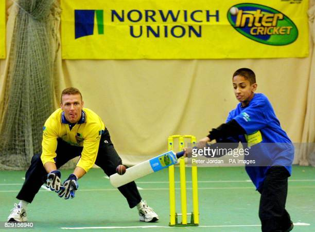 Pavanveer Randhawa age 12 from Cranford Community College bats as Alec Stewart England Cricket player helps out with coaching at the Middlesex County...