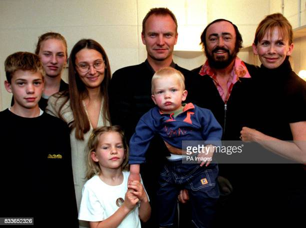 Pavarotti and his girfriend Nicoletta pose with Sting and his partner Trudie Styler and their children