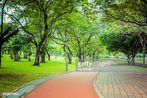 Paved path in urban park, Kuala Lumpur, Federal Territory of Kuala Lumpur, Malaysia