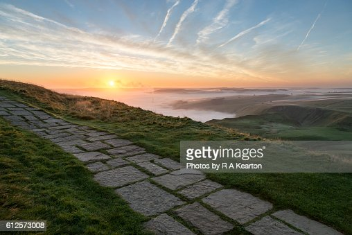 Paved path on the summit of Mam Tor at sunrise : Stock Photo