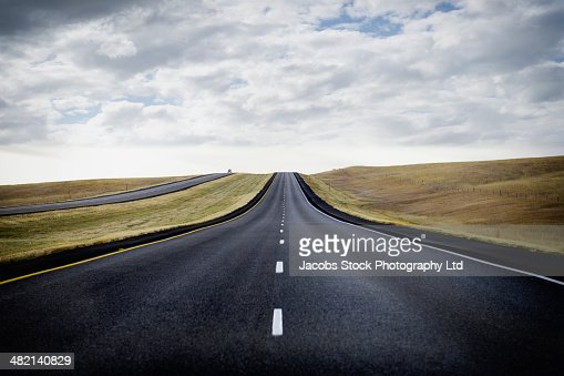 Paved road through rural landscape