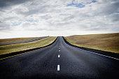 Paved road through rural landscape