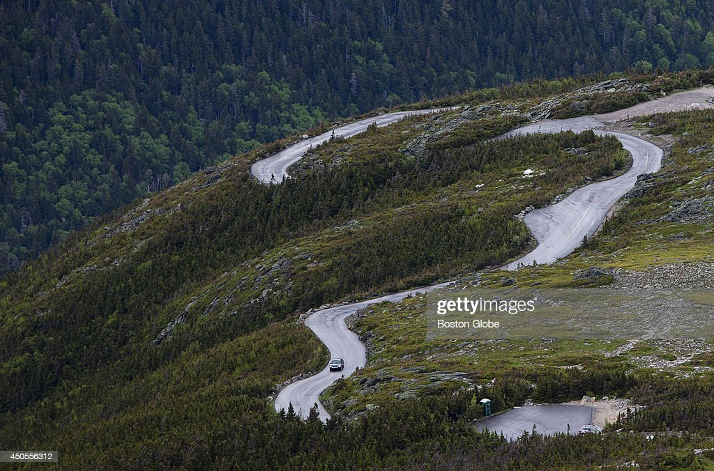 A paved road winds through Mount Washington on Thursday afternoon, June 12, 2014 in Coos County New Hampshire. Around 5000 feet, the paved road turns to dirt, and the travel conditions to the observatory become treacherous with the weather.