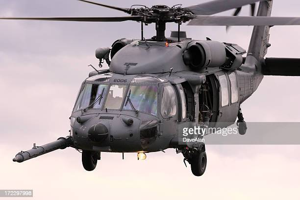 PaveHawk helicopter in flight in a gray sky