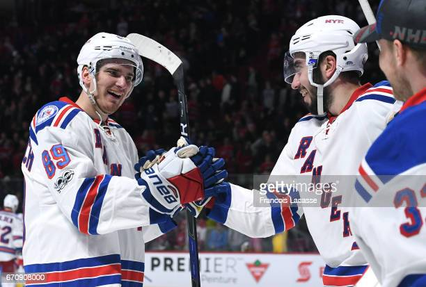 Pavel Buchnevich and Mika Zibanejad of the New York Rangers celebrate after defeating the Montreal Canadiens in Game Five of the Eastern Conference...