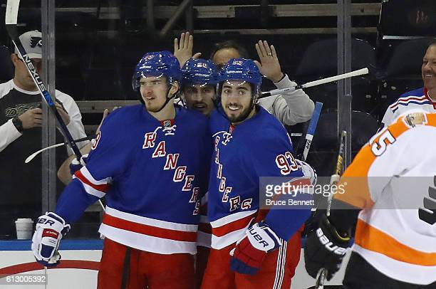 Pavel Buchnevich of the New York Rangers celebrates his first period goal against the Philadelphia Flyers and is joined by Chris Kreider and Mika...