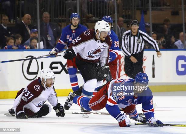 Pavel Buchnevich of the New York Rangers is tripped up during the third period against the Colorado Avalanche at Madison Square Garden on October 5...