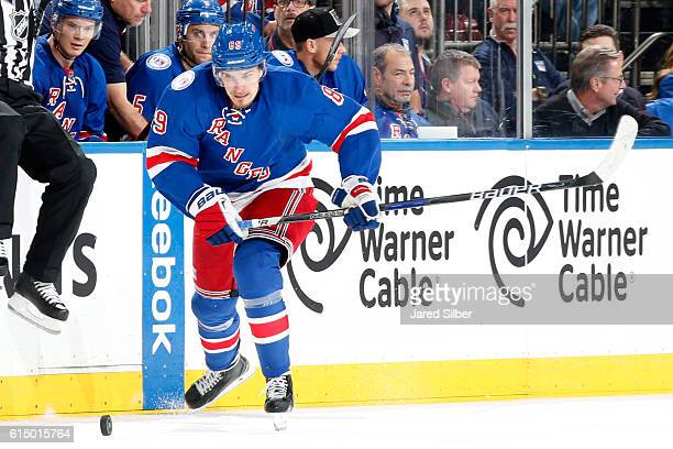 Pavel Buchnevich of the New York Rangers skates with the puck against the New York Islanders at Madison Square Garden on October 13 2016 in New York...