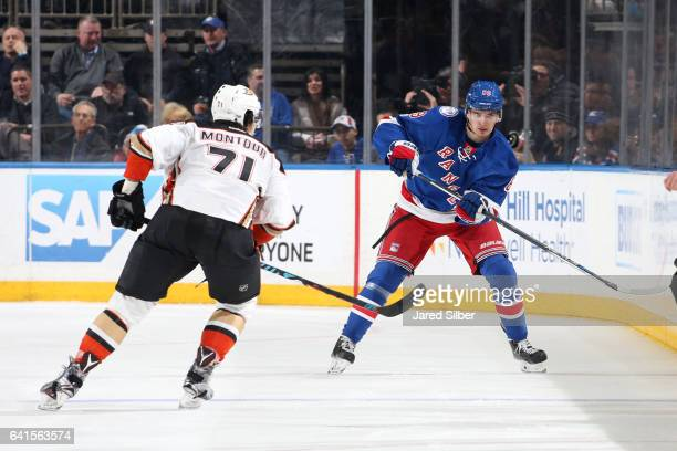 Pavel Buchnevich of the New York Rangers skates with the puck against Brandon Montour of the Anaheim Ducks at Madison Square Garden on February 7...