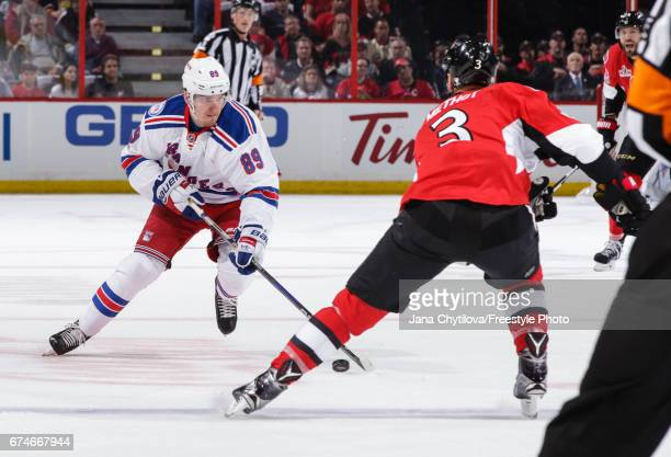 Pavel Buchnevich of the New York Rangers skates with the puck against Marc Methot of the Ottawa Senators in Game One of the Eastern Conference Second...