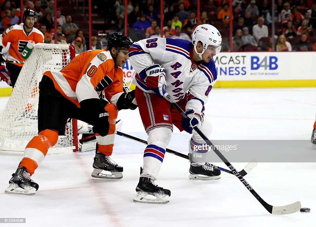 Pavel Buchnevich #89 of the New York Rangers takes the puck as Brayden Schenn #10 of the Philadelphia Flyers defends during a preseason game on October 3, 2016 at Wells Fargo Center in Philadelphia, Pennsylvania.