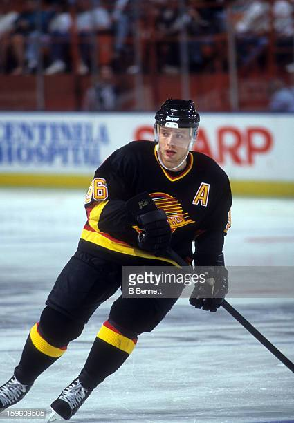 Pavel Bure of the Vancouver Canucks skates on the ice during an NHL game against the Los Angeles Kings circa 1997 at the Great Western Forum in...