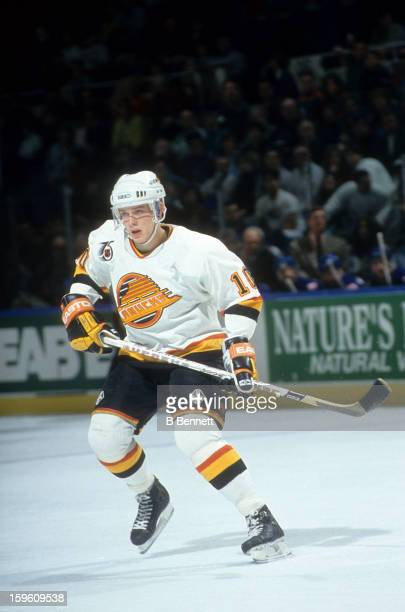 Pavel Bure of the Vancouver Canucks skates on the ice during an NHL game circa 1992 at the Pacific Coliseum in Vancouver British Columbia Canada
