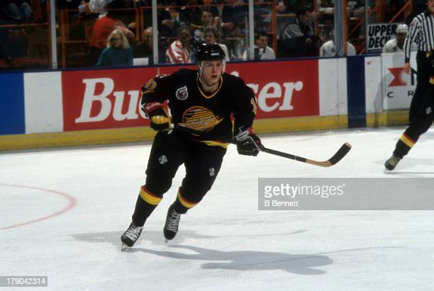 Pavel Bure of the Vancouver Canucks skates on the ice during an NHL game against the Los Angeles Kings circa 1993 at the Great Western Forum in...