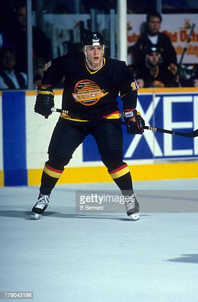 Pavel Bure of the Vancouver Canucks skates on the ice during an NHL game against the Winnipeg Jets circa 1994 at the Winnipeg Arena in Winnipeg...