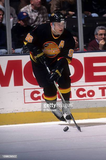 Pavel Bure of the Vancouver Canucks skates with the puck during an NHL game against the New York Rangers on November 11 1996 at the Madison Square...