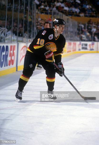 Pavel Bure of the Vancouver Canucks skates with the puck during an NHL game against the New Jersey Devils circa 1993 at the Brendan Byrne Arena in...