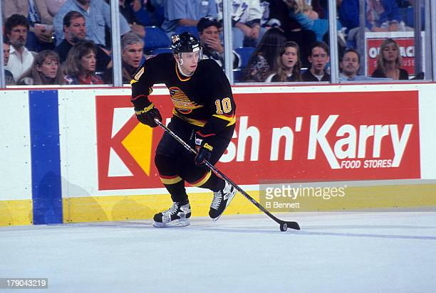 Pavel Bure of the Vancouver Canucks skates with the puck during an NHL game against the Tampa Bay Lighting circa 1992 at the Expo Hall in Tampa...