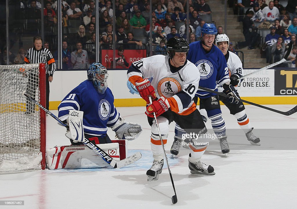 <a gi-track='captionPersonalityLinkClicked' href=/galleries/search?phrase=Pavel+Bure&family=editorial&specificpeople=209299 ng-click='$event.stopPropagation()'>Pavel Bure</a> skates in the Hockey Hall of Fame Legends Game at the Air Canada Centre on November 11, 2012 in Toronto, Canada. Bure will be inducted into the Hockey Hall of Fame at a ceremony at the Hall on November 12.