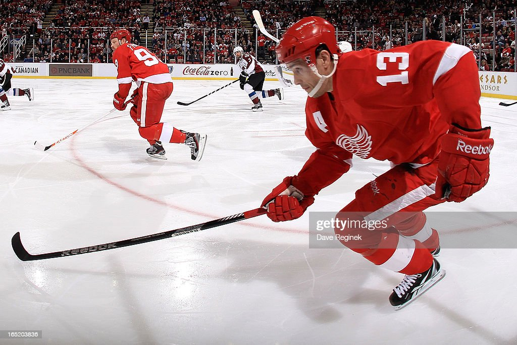 <a gi-track='captionPersonalityLinkClicked' href=/galleries/search?phrase=Pavel+Datsyuk&family=editorial&specificpeople=202893 ng-click='$event.stopPropagation()'>Pavel Datsyuk</a> #13 and <a gi-track='captionPersonalityLinkClicked' href=/galleries/search?phrase=Johan+Franzen&family=editorial&specificpeople=624356 ng-click='$event.stopPropagation()'>Johan Franzen</a> #93 of the Detroit Red Wings skate up ice during a NHL game against the Colorado Avalanche at Joe Louis Arena on April 1, 2013 in Detroit, Michigan.