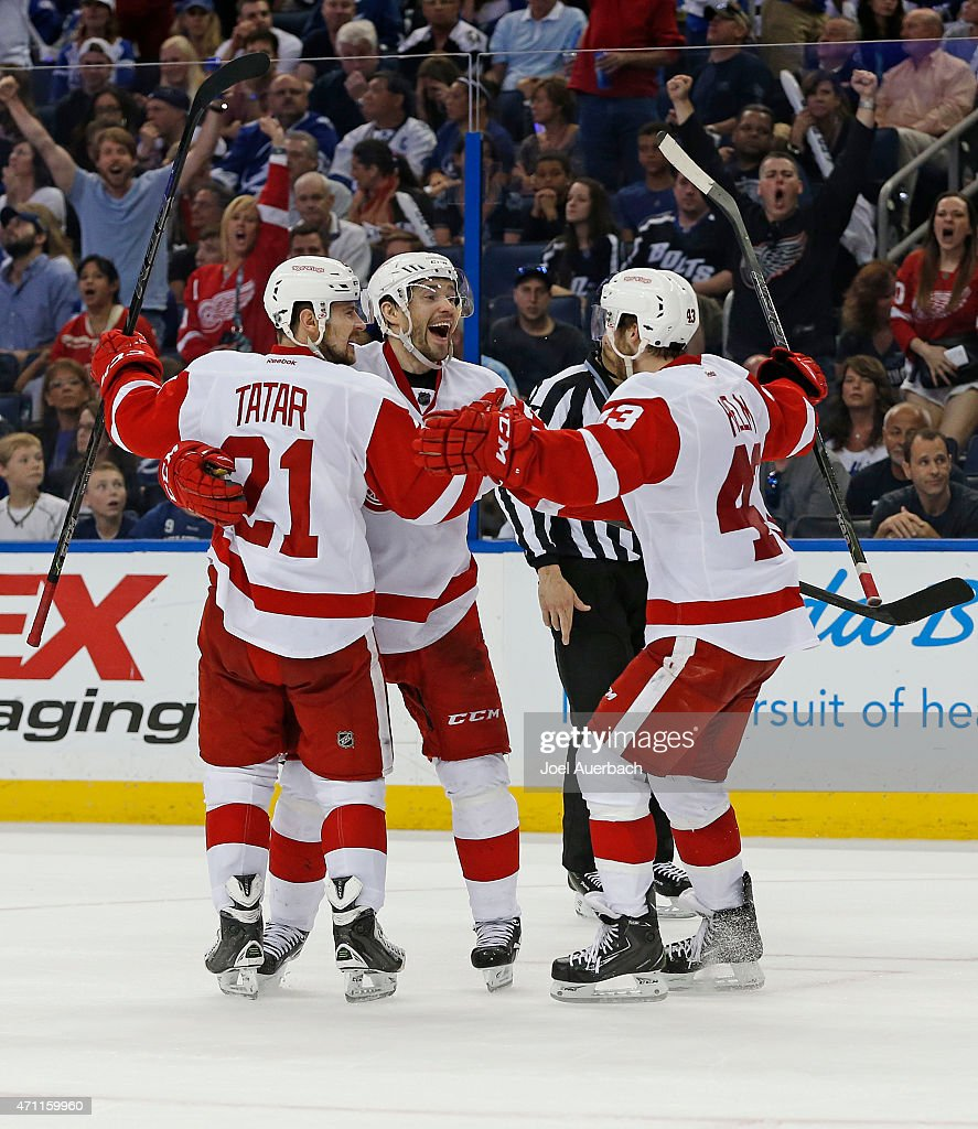 <a gi-track='captionPersonalityLinkClicked' href=/galleries/search?phrase=Pavel+Datsyuk&family=editorial&specificpeople=202893 ng-click='$event.stopPropagation()'>Pavel Datsyuk</a> #13 is congratulated by <a gi-track='captionPersonalityLinkClicked' href=/galleries/search?phrase=Tomas+Tatar&family=editorial&specificpeople=5652303 ng-click='$event.stopPropagation()'>Tomas Tatar</a> #21 and <a gi-track='captionPersonalityLinkClicked' href=/galleries/search?phrase=Darren+Helm&family=editorial&specificpeople=3949334 ng-click='$event.stopPropagation()'>Darren Helm</a> #43 of the Detroit Red Wings after scoring a goal against the Tampa Bay Lightning during the third period in Game Five of the Eastern Conference Quarterfinals during the 2015 NHL Stanley Cup Playoffs at the Amalie Arena on April 25, 2015 in Tampa, Florida. The Red Wings defeated the Lightning 4-0.